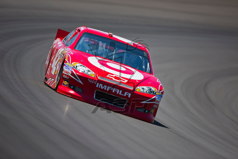 BROOKLYN, MI - JUN 14, 2012:  Juan Pablo Montoya (42) brings his car through the turns during the second test session for the Quicken Loans 400 at the Michigan International Speedway in Brooklyn, MI.