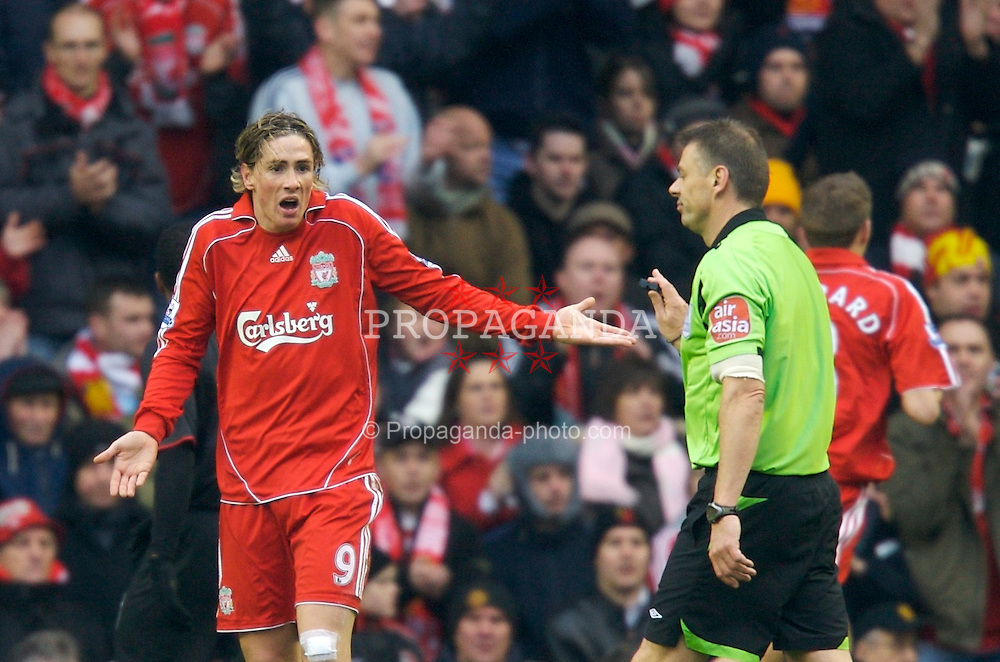 LIVERPOOL, ENGLAND - Sunday, December 16, 2007: Liverpool's Fernando Torres and referee Mark Halsey during the Premiership match against Manchester United at Anfield. (Photo by David Rawcliffe/Propaganda)