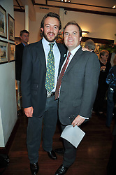 Left to right, ALEX MAVROS and LORD DALMENY at a reception in aid of Save The Elephants held at Patrick Mavros, 104-106 Fulham Road, Lodon SW3 on 23rd September 2009.