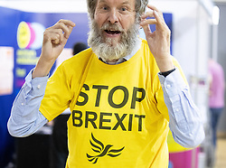 © Licensed to London News Pictures . 14/09/2019. Bournemouth, UK. A man wearing a STOP BREXIT t-shirt at the exhibition at the conference . The first day of the Liberal Democrat Party Conference in Bournemouth . Photo credit: Joel Goodman/LNP