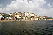 India, Rajasthan, Udaipur A boat ride in lake Pichola, The city palace