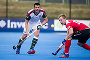 Surbiton's William Marshall passes the ball past Barry Middleton of Holcombe. Holcombe v Surbiton - Semi-Final - Men's Hockey League Finals, Lee Valley Hockey & Tennis Centre, London, UK on 22 April 2017. Photo: Simon Parker