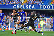 Chelsea Midfielder Eden Hazard (10) beats Leicester City Defender Jeff Schlupp (15)  during the Barclays Premier League match between Chelsea and Leicester City at Stamford Bridge, London, England on 15 May 2016. Photo by Jon Bromley.