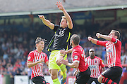 defender Dave Winfield gets up highest during the Sky Bet League 2 match between Exeter City and York City at St James' Park, Exeter, England on 22 August 2015. Photo by Simon Davies.