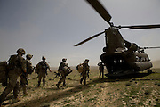 Members of the 82nd Airborne's 1/508 Alpha Company board a Chinook to return to Forward Operation Base Diablo after completing a mission in remote Kandahar province, Afghanistan on Wednesday, March 28, 2007.