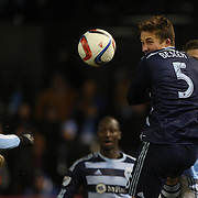 Matt Besler, Sporting KC, heads clear during the New York City FC Vs Sporting Kansas City, MSL regular season football match at Yankee Stadium, The Bronx, New York,  USA. 27th March 2015. Photo Tim Clayton