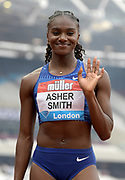 Jul 21, 2019; London, United Kingdom; Dina Asher-Smith (GBR) poses after placing second in the women's 100m in 10.92 during the London Anniversary Games at London Stadium at  Queen Elizabeth Olympic Park.