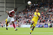 AFC Wimbledon striker Lyle Taylor (33) and Northampton Town defender Gabriel Zakuani (6) in action during the EFL Sky Bet League 1 match between Northampton Town and AFC Wimbledon at Sixfields Stadium, Northampton, England on 20 August 2016. Photo by Stuart Butcher.