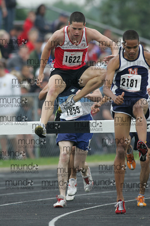 Hamilton, Ontario ---05/06/08--- Colin Lavigne of Sir Winston Churchill in Hamilt competes in the steeplechase at the 2008 OFSAA Track and Field meet in Hamilton, Ontario..Sean Burges