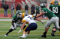18 October 2014:  Anfernee Roberts attempts to fake out Jack Asquini during an NCAA division 3 football game between the Augustana Vikings and the Illinois Wesleyan Titans in Tucci Stadium on Wilder Field, Bloomington IL