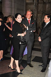 The DOWAGER VISCOUNTESS ROTHERMERE and GEOFFROY MEDINGER MD of Van Cleef & Arpels at the opening of the Victoria & Albert Museum's latest exhibition 'Grace Kelly: Style Icon' opened by His Serene Highness Prince Albert of Monaco at the V&A on 15th April 2010.