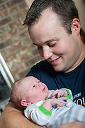 Josh and Anna Duggar with newborn son Michael James, and daughter Mackynzie. June of 2011.