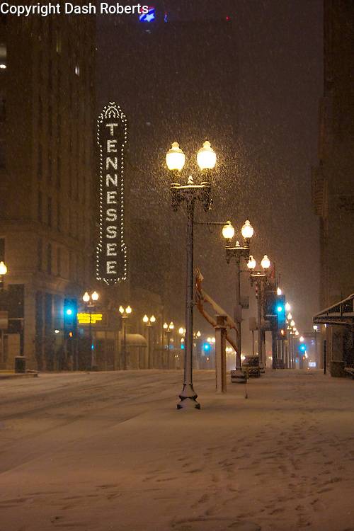 Snow falls on Gay Street in downtown Knoxville, TN. on Feb. 12, 2014.