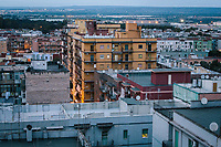 TARANTO, ITALY - 22 FEBRUARY 2018: The concrete flats of Tamburi, the working-class district adjacent to the ILVA steel mill, are seen here in Taranto, Italy, on February 22nd 2018.<br /> <br /> Taranto, a  formerly lovely town on the Ionian Sea has for the last several decades been dominated by the ILVA steel mill, the largest steel plant in Europe. It was built by the government in the 1960s as a means of delivering jobs to the economically depressed south, but has been implicated for a cancer as dioxin and mercury have seeped into local groundwater, tainting the food supply, while poisoning the bay and its once-lucrative mussels.