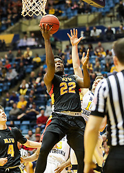 Dec 16, 2017; Morgantown, WV, USA; Wheeling Jesuit Cardinals forwardz Jeremiah Wilson (22) drives and shoot a layup during the first half against the West Virginia Mountaineers at WVU Coliseum. Mandatory Credit: Ben Queen-USA TODAY Sports