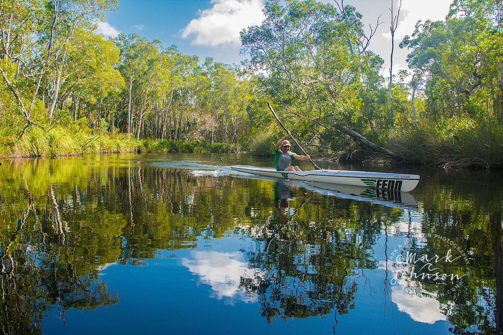 Man paddling a kayak in the Noosa River, Cooloola National Park, Queensland, Australia