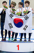 Jung Jiwoong & Kim Byungjoon & Lee Hyo Been & Park Se Yeong with Korean flag during medal ceremony of the Relay Men's 3000 Meters on day three of the 2013 ISU Short Track Speed Skating Junior World Championships at Torwar Ice Hall on February 24, 2013 in Warsaw, Poland...Poland, Warsaw, February 24, 2013...Picture also available in RAW (NEF) or TIFF format on special request...For editorial use only. Any commercial or promotional use requires permission...Photo by © Adam Nurkiewicz / Mediasport