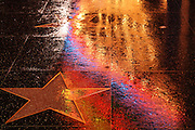 Colorful rain reflections on Hollywood Blvd Walk of Fame Star