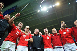 LILLE, FRANCE - Friday, July 1, 2016: Wales players celebrate in the team huddle following a 3-1 victory over Belgium and reaching the Semi-Final during the UEFA Euro 2016 Championship Quarter-Final match at the Stade Pierre Mauroy. Gareth Bale, Aaron Ramsey, goalkeeping coach Martyn Margetson, Andy King, George Williams, Joe Ledley. (Pic by David Rawcliffe/Propaganda)