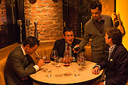 New York, NY, Sept. 30, 2013. Grant Reynolds, wine director at Charlie Bird, serving wine to patrons. (L to R) Michael Liou, Juan Ruiz, and David Beckwith.
