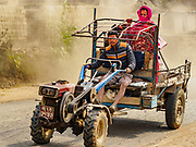 09 MARCH 2017 - BAGMATI, NEPAL:  People ride a tractor in Bhaktapur, Nepal.           PHOTO BY JACK KURTZ