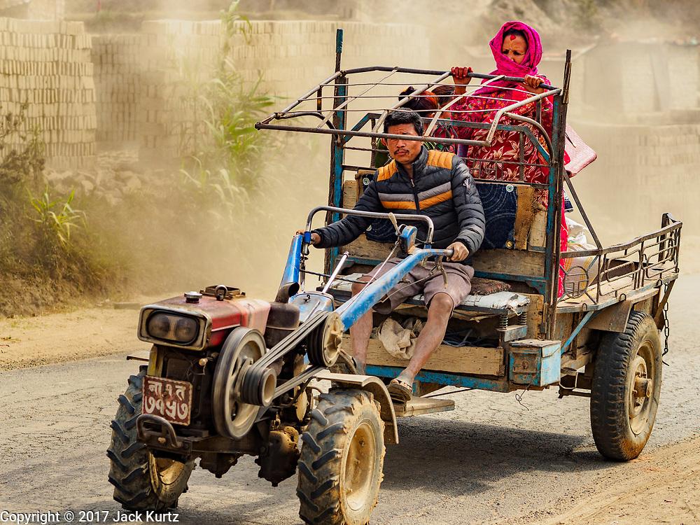 09 MARCH 2017 - BAGMATI, NEPAL:  People ride a tractor in Bhaktapur, Nepal.           PHOTO BY JACK KURTZ