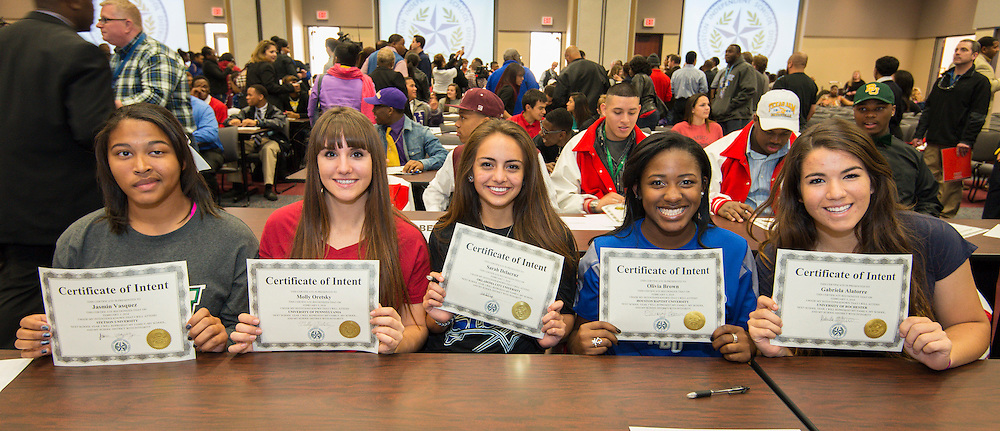 L-R: Bellaire's Jasmin Vasquez (Stetson), Molly Oretsky (Penn), Sarah Delacruz (Oklahoma City University), Olivia Brown (HBU) and Gabriela Alatorre (Rochester) display their certificates of intent during a National Signing Day ceremony at the Region 4 Education Center, February 5, 2014.