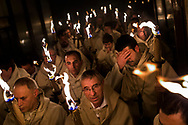Penitents from 'Cristo de la Buena Muerte' or 'Good Dead Christ' brotherhood turn off their torch as they take part in a procession in Zamora, Spain, on the early hours of Tuesday, March 31, 2015. Hundreds of processions take place throughout Spain during the Easter Holy Week.