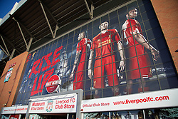 LIVERPOOL, ENGLAND - Saturday, December 21, 2013: Liverpool's Glen Johnson, captain Steven Gerrard and Daniel Sturridge are features on a Warrior advert on the side of the Spion Kop at Anfield. (Pic by David Rawcliffe/Propaganda)