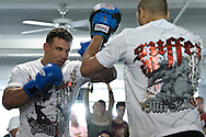 "NEW YORK, NEW YORK, MARCH 25, 2010: Frank Mir (left) works on his striking during the media open work-out sessions for ""UFC 111: St. Pierre vs. Hardy"" at Peak Performance Strength and Conditioning Center in Manhattan on March 25, 2010."