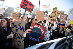 © Licensed to London News Pictures. 15/02/2019. London, UK. Young people shout at a van in Parliament Square during a demonstration against climate change as part of the group 'Youth Strike 4 Climate'. Many children across the UK today walked out of school as part of a global campaign calling for action over climate change. Photo credit : Tom Nicholson/LNP