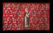 St Anthony tapestry, with St Anthony the hermit with his bell and book, saint protector of the Hospices, and the motto of Nicolas Rolin, Seulle and a star, coat of arms, N and G initials and a bird on a branch, late 15th century, in Les Hospices de Beaune, or Hotel-Dieu de Beaune, a charitable almshouse and hospital for the poor, built 1443-57 by Flemish architect Jacques Wiscrer, and founded by Nicolas Rolin, chancellor of Burgundy, and his wife Guigone de Salins, in Beaune, Cote d'Or, Burgundy, France. The hospital was run by the nuns of the order of Les Soeurs Hospitalieres de Beaune, and remained a hospital until the 1970s. The building now houses the Musee de l'Histoire de la Medecine, or Museum of the History of Medicine, and is listed as a historic monument. Picture by Manuel Cohen
