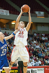 04 February 2006:  Unable to get in front, Rachael Maepaa gets just one hand on Holly Hallstrom as she takes a shot. The Indiana State Sycamores shook the Illinois State Redbirds from the nest with a 75-71 Victory.  There were 3,581 fans on hand, making the audience the  2nd largest women's basketball crowd ever in Redbird Arena on Illinois State University campus in Normal Illinois.