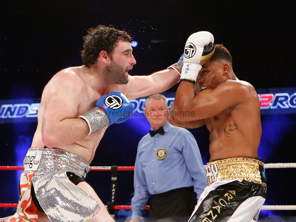 Charleroi, Belgium. 16 Dec, 2017. Nick Kisner is seen punching Ryad Merhy  during the WBA Inter-Continental cruiserweight title fight between Ryad Merhy (Belgium, 23/0/0) and Nick Kisner (USA,19/3/1) in Charleroi, Belgium. Merhy won with a 4th round KO. © Frédéric de Laminne