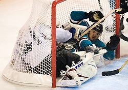 April 22, 2010; San Jose, CA, USA; San Jose Sharks right wing Devin Setoguchi (right) lands in the goalie net with Colorado Avalanche goaltender Craig Anderson (left) during the second period of game five in the first round of the 2010 Stanley Cup Playoffs at HP Pavilion.  San Jose defeated Colorado 5-0. Mandatory Credit: Jason O. Watson / US PRESSWIRE