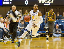 Nov 23, 2015; Morgantown, WV, USA; West Virginia Mountaineers guard Jevon Carter dribbles the ball across mid court during the first half against the Bethune-Cookman Wildcats at WVU Coliseum. Mandatory Credit: Ben Queen-USA TODAY Sports