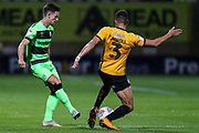 Forest Green Rovers Liam Shephard(2) passes the ball forward under pressure from Cambridge United's Jake Carroll(3) during the EFL Sky Bet League 2 match between Cambridge United and Forest Green Rovers at the Cambs Glass Stadium, Cambridge, England on 2 October 2018.