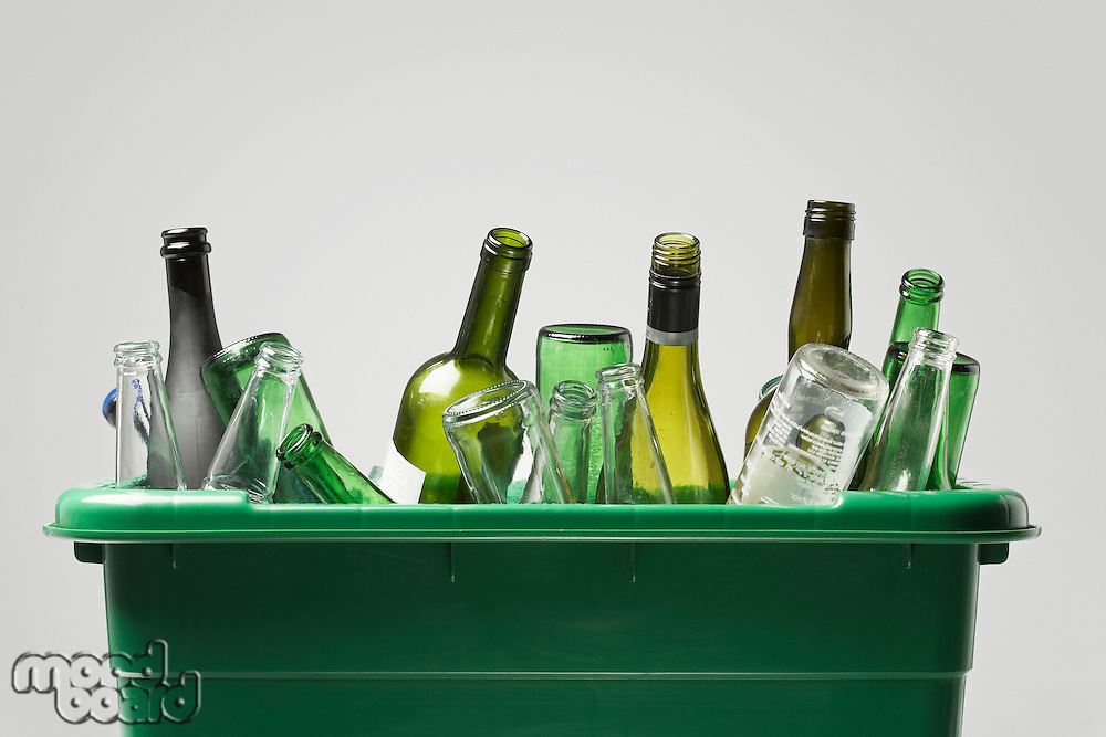 Empty bottles in green container