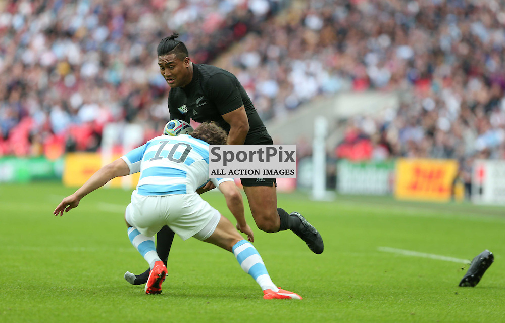 Julian Savea loses boot, in a challenge from Nicolas Sanchez of New Zealand, during the Rugby World Cup New Zealand v Argentina, Sunday 20 September 2015, Wembley Stadium (Photo by Mike Poole)