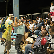 AUGUST 27, 2018--Cata&ntilde;o---PUERTO RICO--<br /> Actor Maximiliano Rivas, in yellow poncho, interacts with residents during a performance of La Familia Perez in the Pueblo sector of Cata&ntilde;o.<br /> (Photo by Angel Valentin/Freelance)