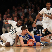 Jaren Sina, (right), Seton Hall, dives for a loose ball while challenged by JayVaughn Pinkston, (left), Villanova,  during the Villanova Wildcats Vs Seton Hall Pirates basketball game during the Big East Conference Tournament at Madison Square Garden, New York, USA. 12th March 2014. Photo Tim Clayton