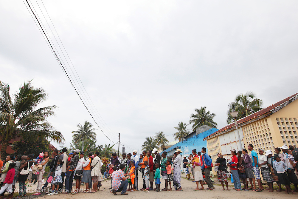Patients gather to hear if they are on the surgery schedule on patient announcement day. Operations Smile's 2015 mission to Tamatave at Tamatave General Hospital. Antsirabe Clinic Project sponsored by the Swedish Postal Code lottery. Madagascar. September 2015.<br /> (Operation Smile Photographer &ndash; Zute Lightfoot)
