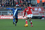 Birmingham City midfielder David Davis closes down Bristol City defender Mark Little during the Sky Bet Championship match between Bristol City and Birmingham City at Ashton Gate, Bristol, England on 30 January 2016. Photo by Alan Franklin.