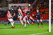 A melee of players from both teams go for the ball from a free kick during the EFL Sky Bet League 1 match between Doncaster Rovers and Barnsley at the Keepmoat Stadium, Doncaster, England on 15 March 2019.