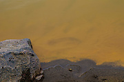 Rich, orange sediment from the Gold King Mine wastewater spill settles along the banks of the Animas River just below Baker's Bridge.