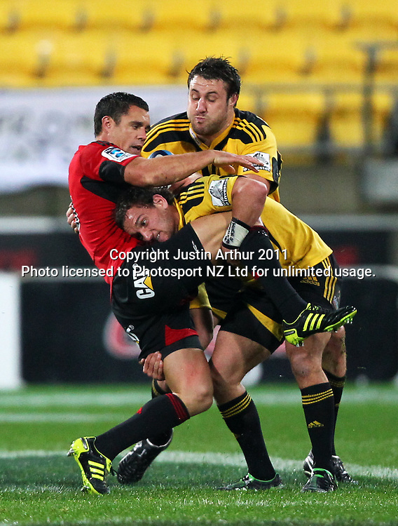 Aaron Cruden spear tackles Dan Cater .Super15 rugby union match - Crusaders v Hurricanes at Westpac Stadium, Wellington, New Zealand on Saturday, 18 June 2011. Photo: Justin Arthur / photosport.co.nz