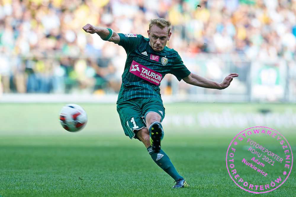 Sebastian Mila of Slask Wroclaw shoots on goal during international friendly soccer match between WKS Slask Wroclaw and BVB Borussia Dortmund on Municipal Stadium in Wroclaw, Poland.<br /> <br /> Poland, Wroclaw, August 6, 2014<br /> <br /> Picture also available in RAW (NEF) or TIFF format on special request.<br /> <br /> For editorial use only. Any commercial or promotional use requires permission.<br /> <br /> Mandatory credit:<br /> Photo by &copy; Adam Nurkiewicz / Mediasport