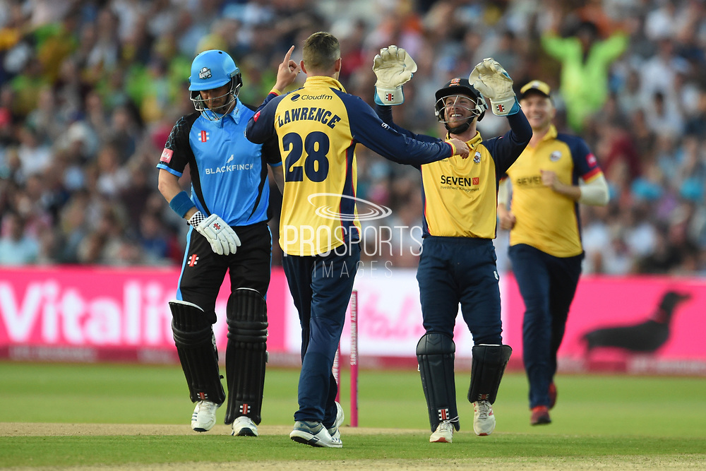 Daniel Lawrence and Adam Wheater of Essex Eagles celebrate the wicket of Hamish Rutherford during the Vitality T20 Finals Day 2019 match between Worcestershire County Cricket Club and Essex County Cricket Club at Edgbaston, Birmingham, United Kingdom on 21 September 2019.