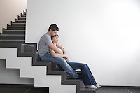 Young couple sit on staircase  copyspace