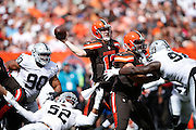 CLEVELAND, OH - SEPTEMBER 27: Josh McCown #13 of the Cleveland Browns looks to pass while under pressure from Khalil Mack #52 of the Oakland Raiders during a game at FirstEnergy Stadium on September 27, 2015 in Cleveland, Ohio. The Raiders defeated the Browns 27-20. (Photo by Joe Robbins)